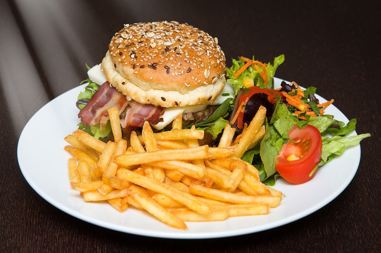 Plate with burger, fries and salad.