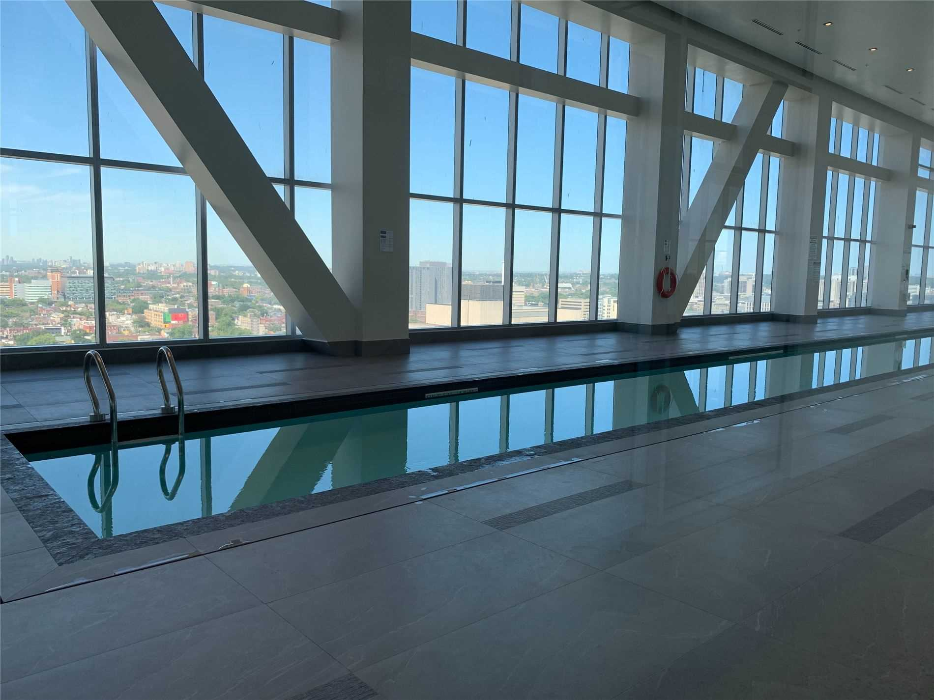 Long swimming pool at The Residences of 488 University Avenue.