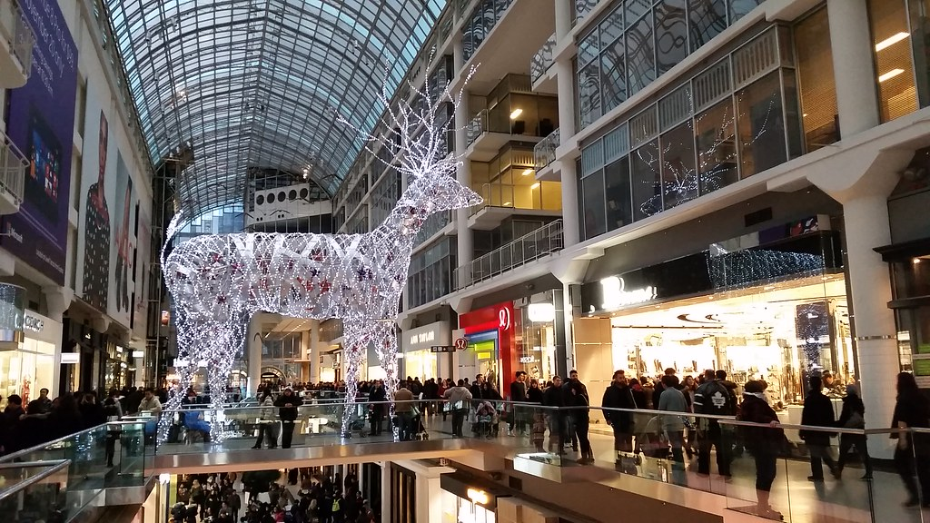 Toronto Eaton Centre during Christmas with giant crystal reindeer display.