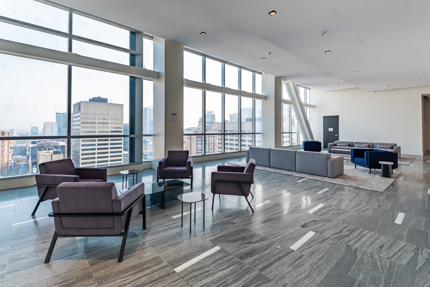 Visitor lounge at 488 University Ave with sofas and tables.