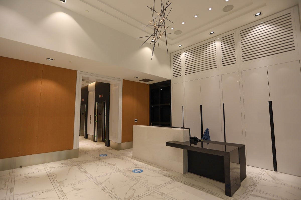 Stanley Condos lobby with chic light-fixture.
