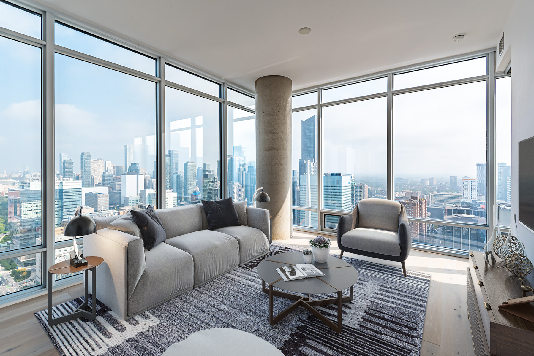 488 University Ave living room with glass walls and view of Toronto.