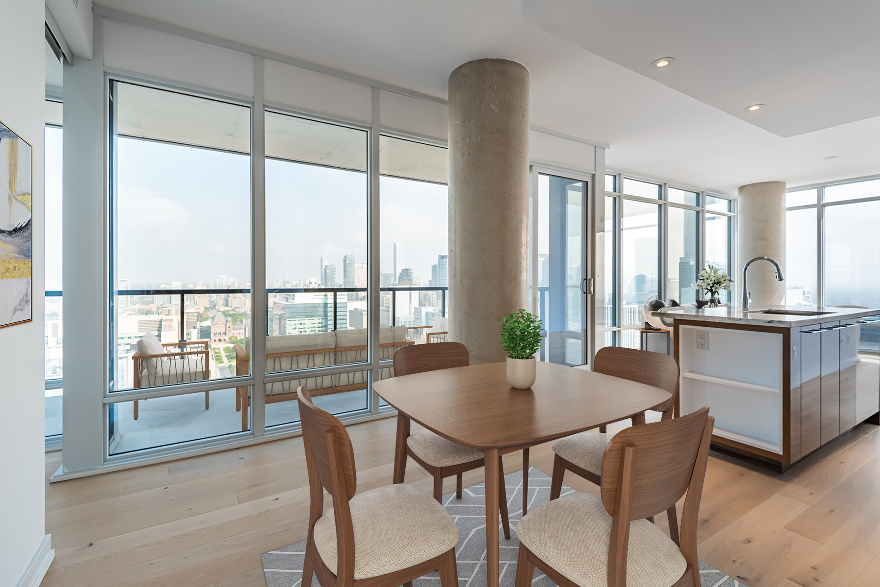 Condo dining room with table, chairs and view of Toronto.