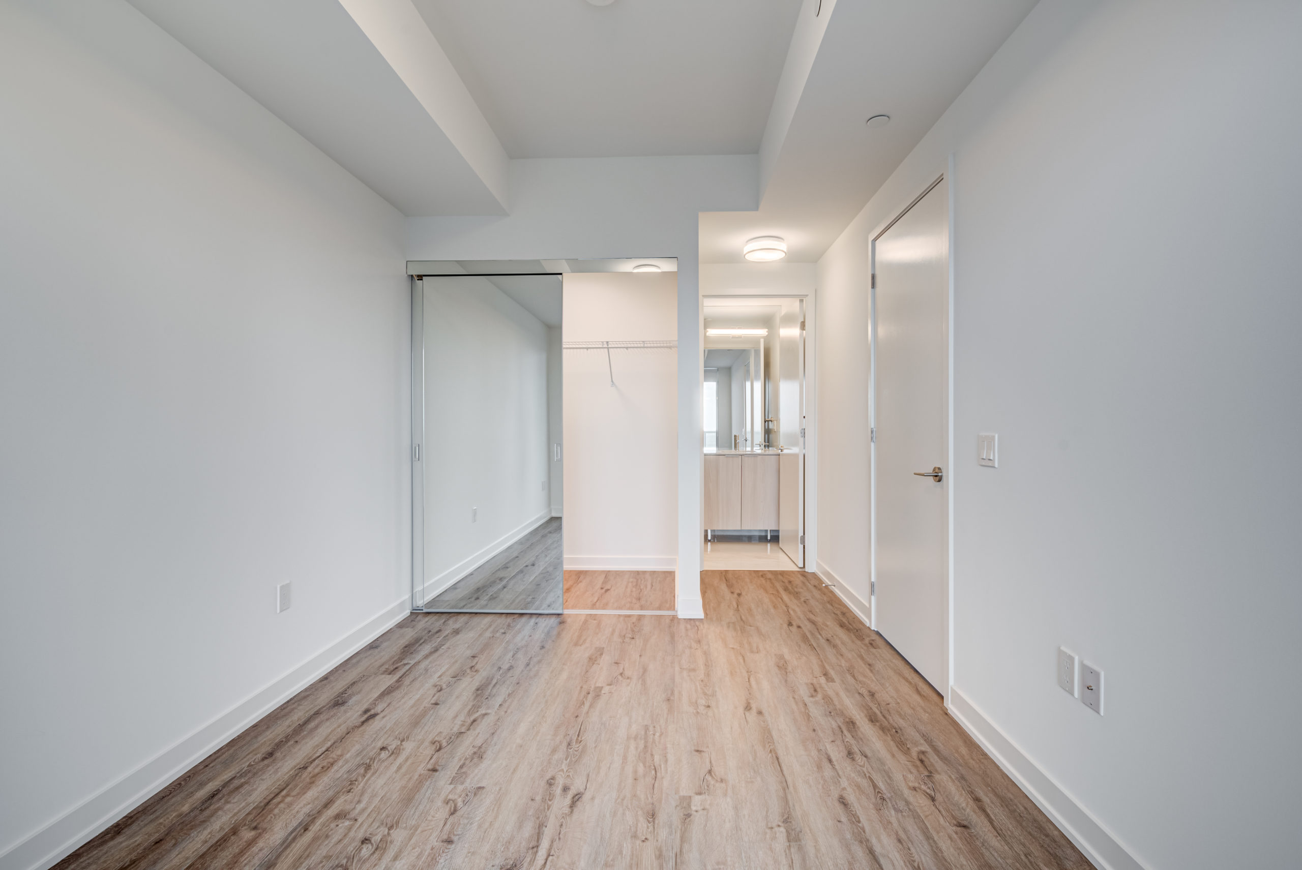 15 Queens Quay E Unit 1901 master bedroom with split layout.