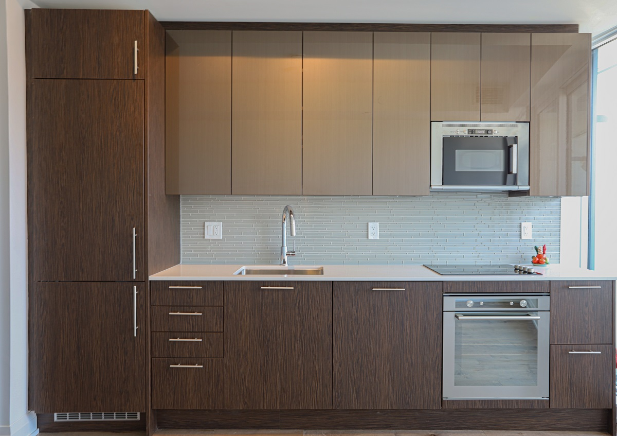 Linear kitchen with recessed appliances.