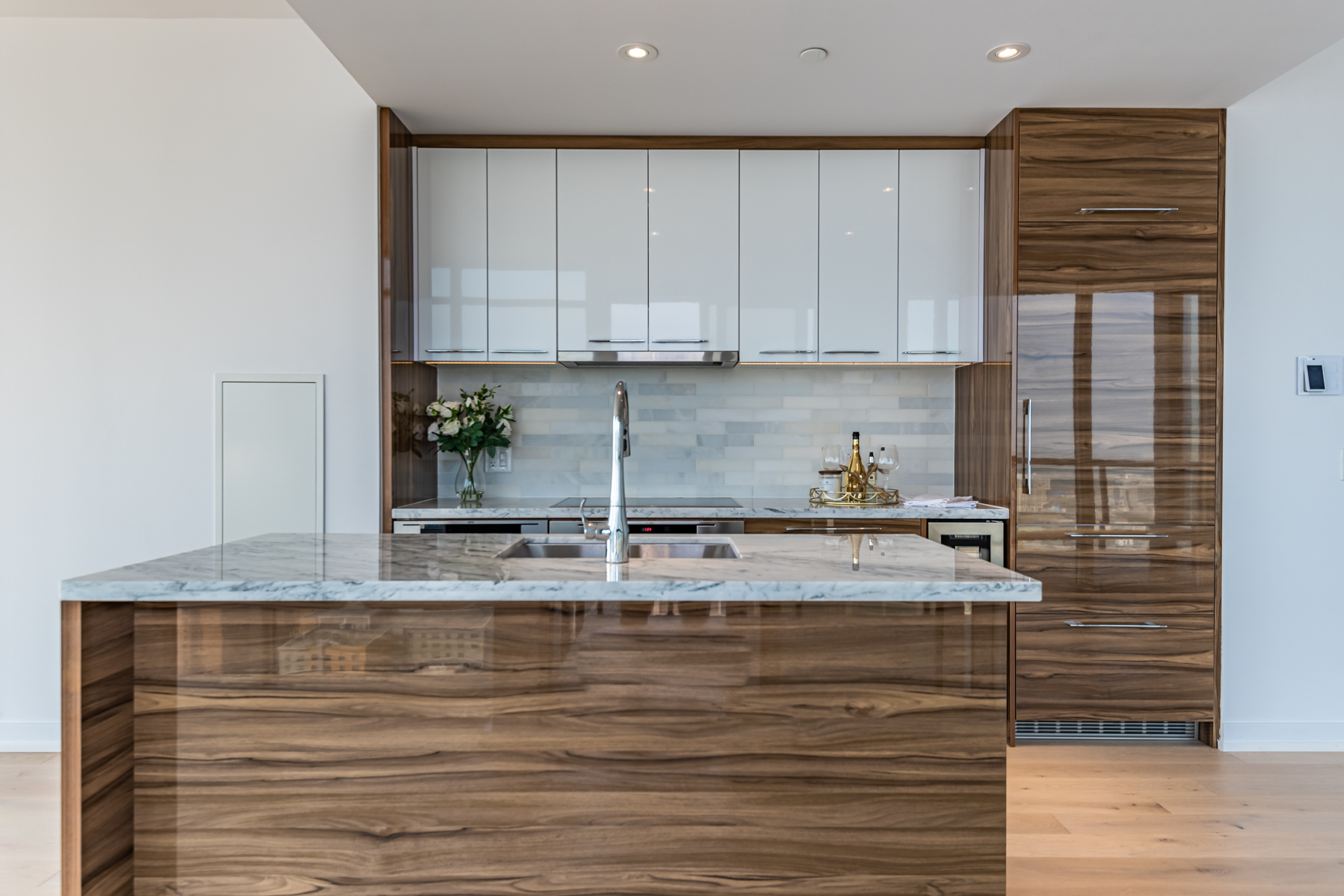 488 University Ave kitchen with gleaming cabinets, drawers and kitchen island.