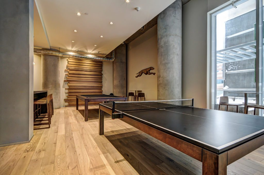Karma Condos rec room with ping pong tables.