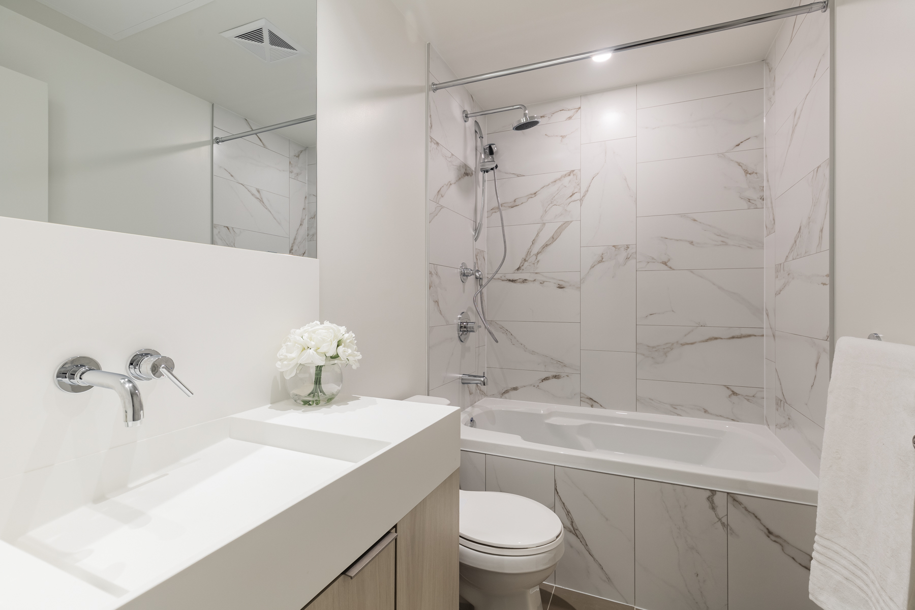 20 Richardson St Suite 3108 second bedroom with soaker tub and beautiful marble tiles.