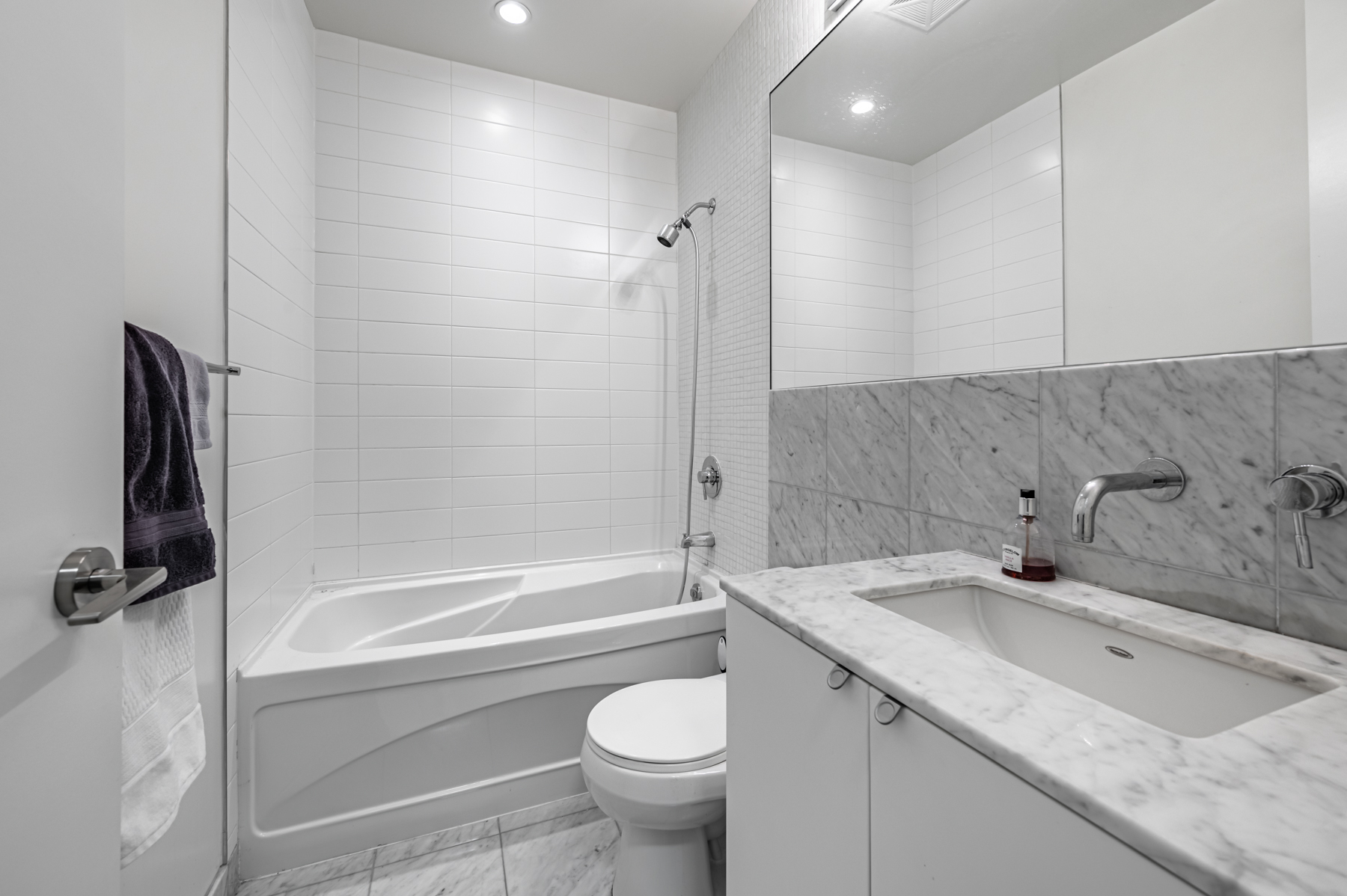 Ensuite bath with gray walls, floors, counters - 380 Macpherson Ave # 517.