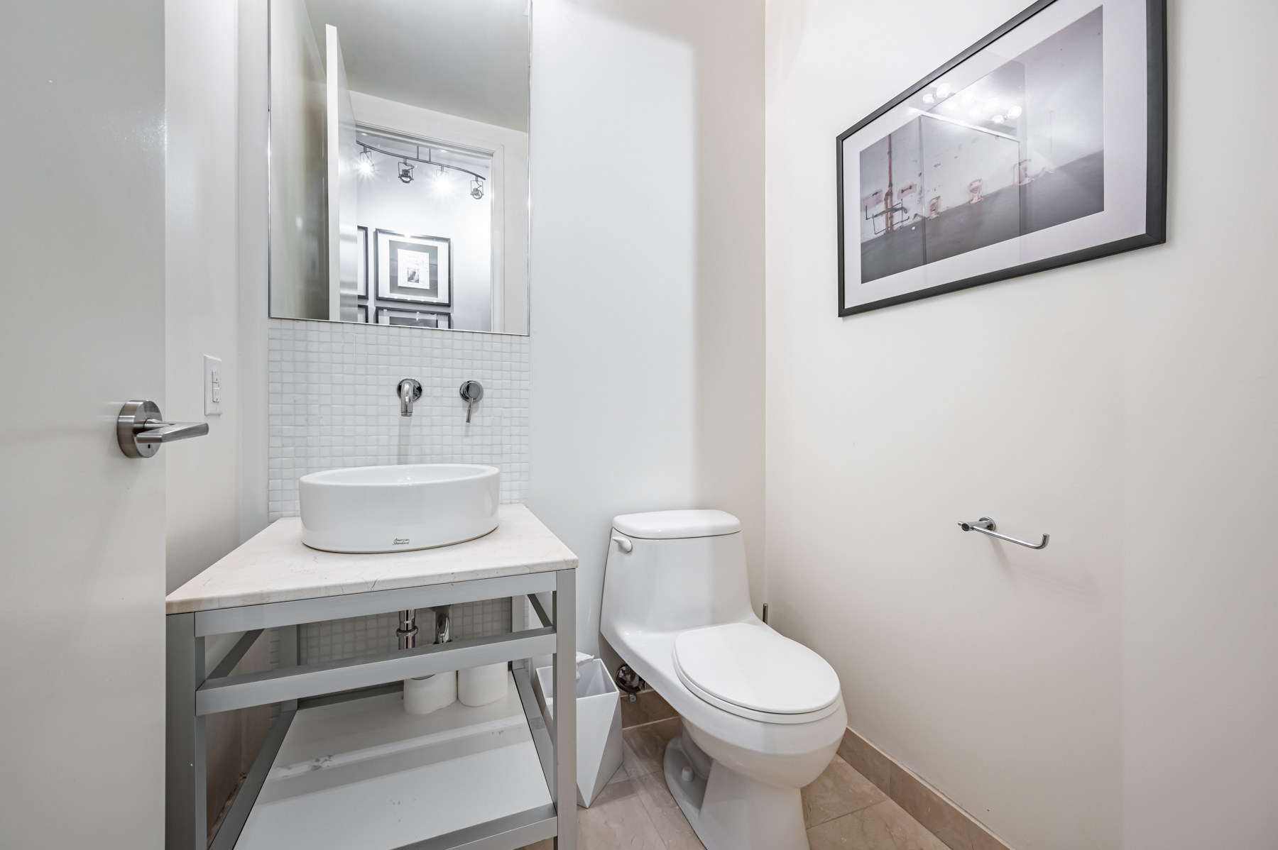 Powder room with raised vessel sink bowl – 380 Macpherson Ave Suite 517.