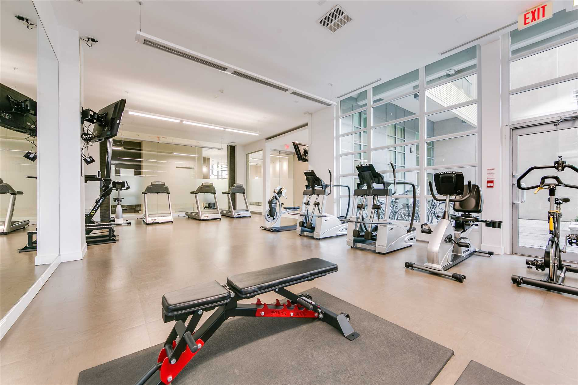 Gym with treadmills and exercise bike at Madison Avenue Lofts.