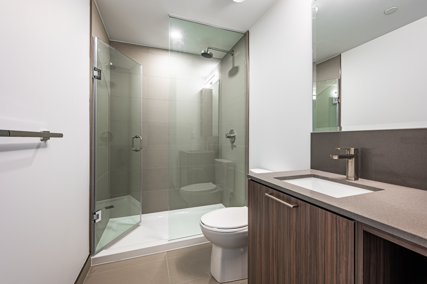 Large walk-in shower with glass doors.