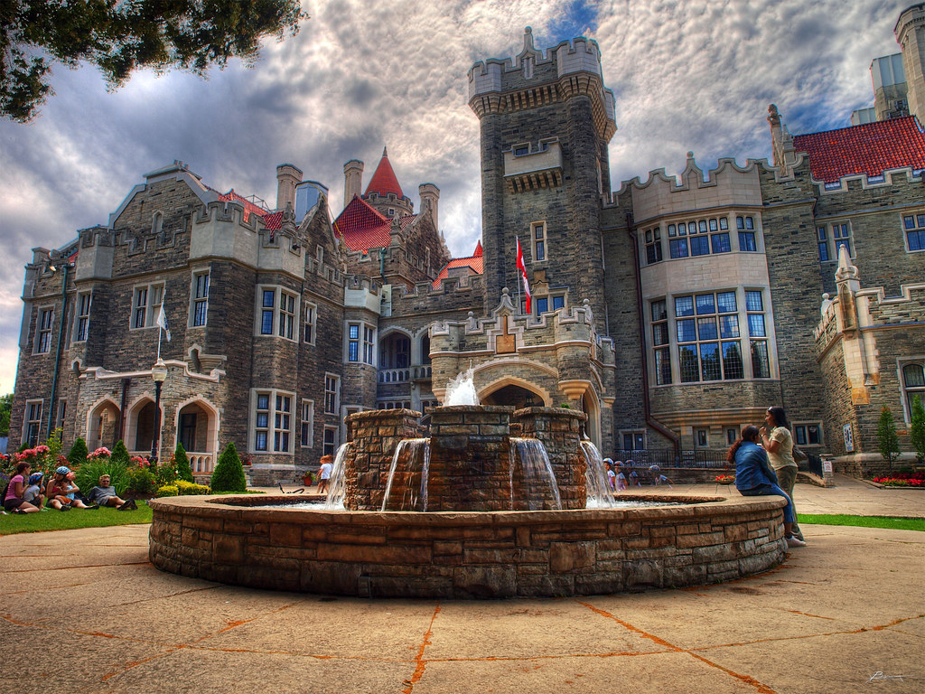 Exterior of Casa Loma, a Gothic Revival mansion with fountain in Toronto.