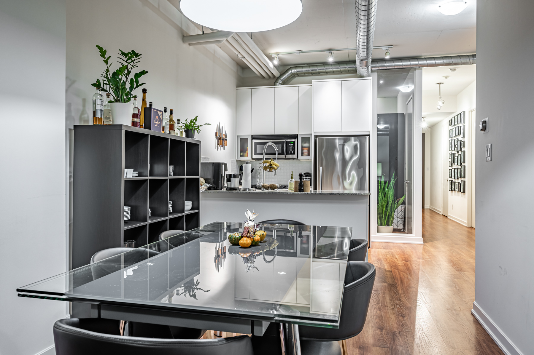 Modern-industrial style dining room and kitchen - 380 Macpherson Ave Unit 517.
