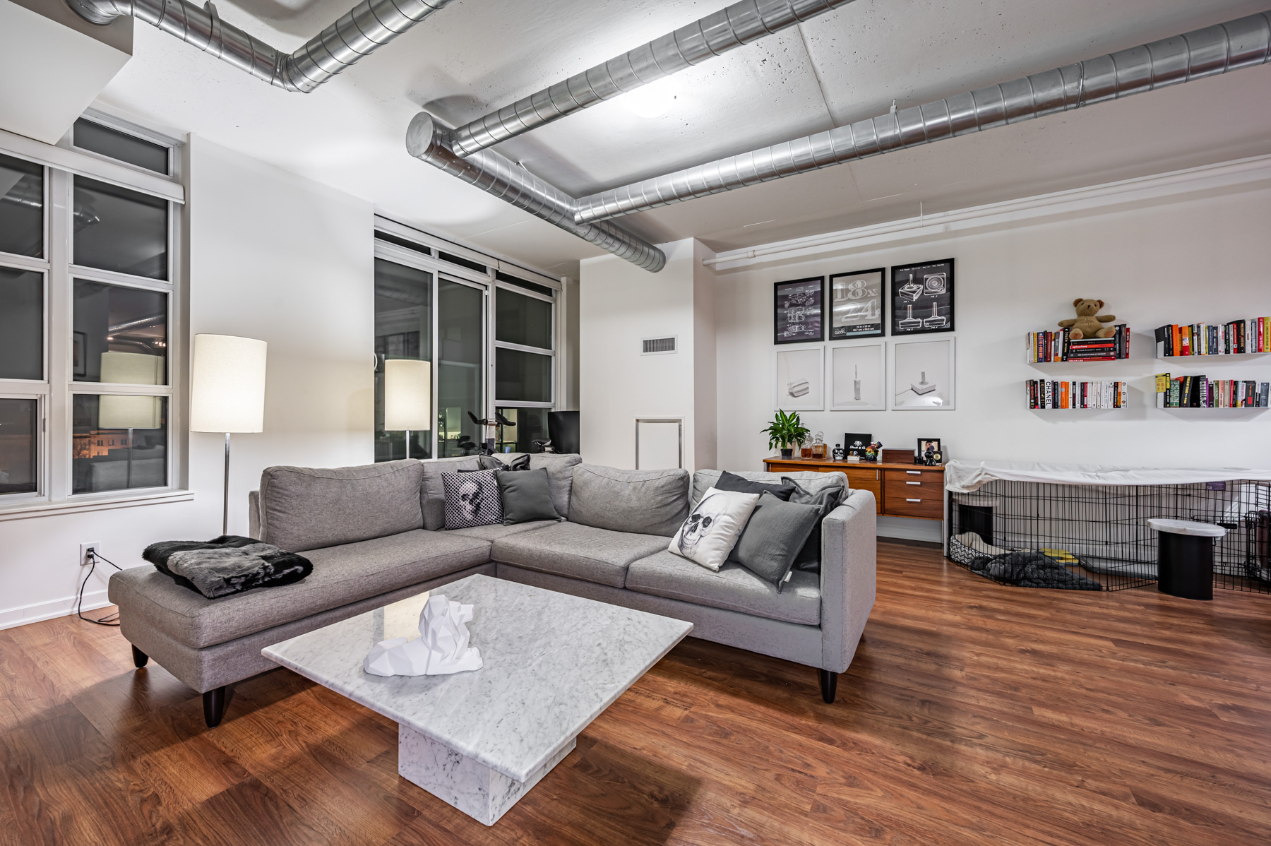 Condo living room with hardwood floors and gray walls – 380 Macpherson Ave Suite 517.
