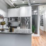 Big, stylish kitchen with gray colour scheme.