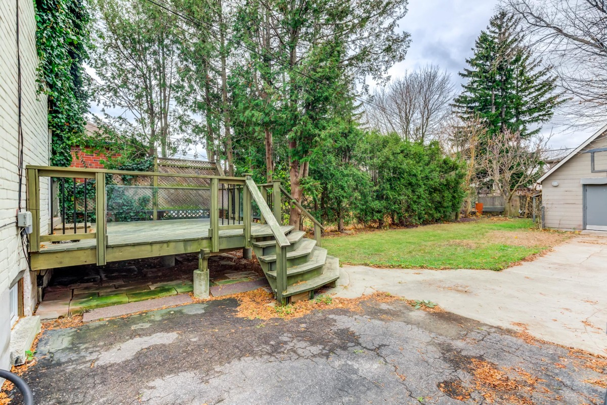 Large wooden deck and backyard of 54 Huntington Ave.