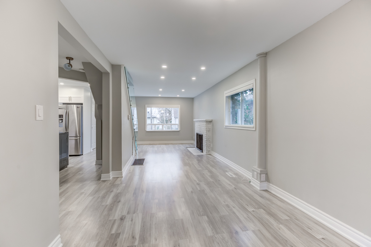 54 Huntington Ave – brightly lit house with pot-lights, fireplace and large windows.