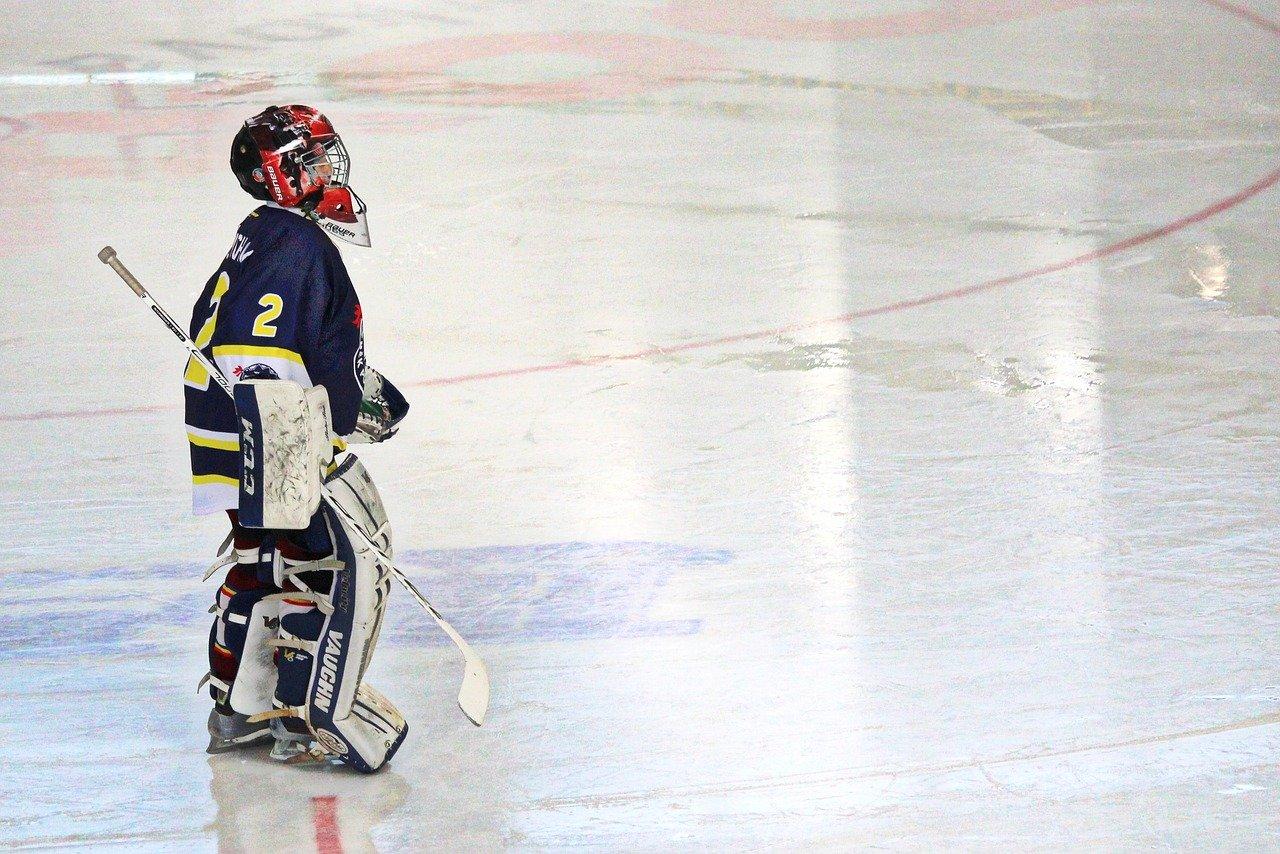 Kid in hockey gear