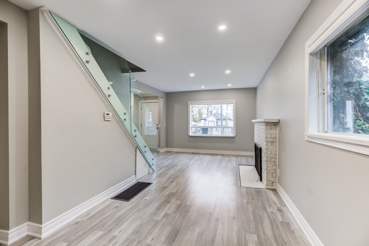 54 Huntington Ave – new pot-lights, glass-paneled stairs, gray walls and laminate floors.