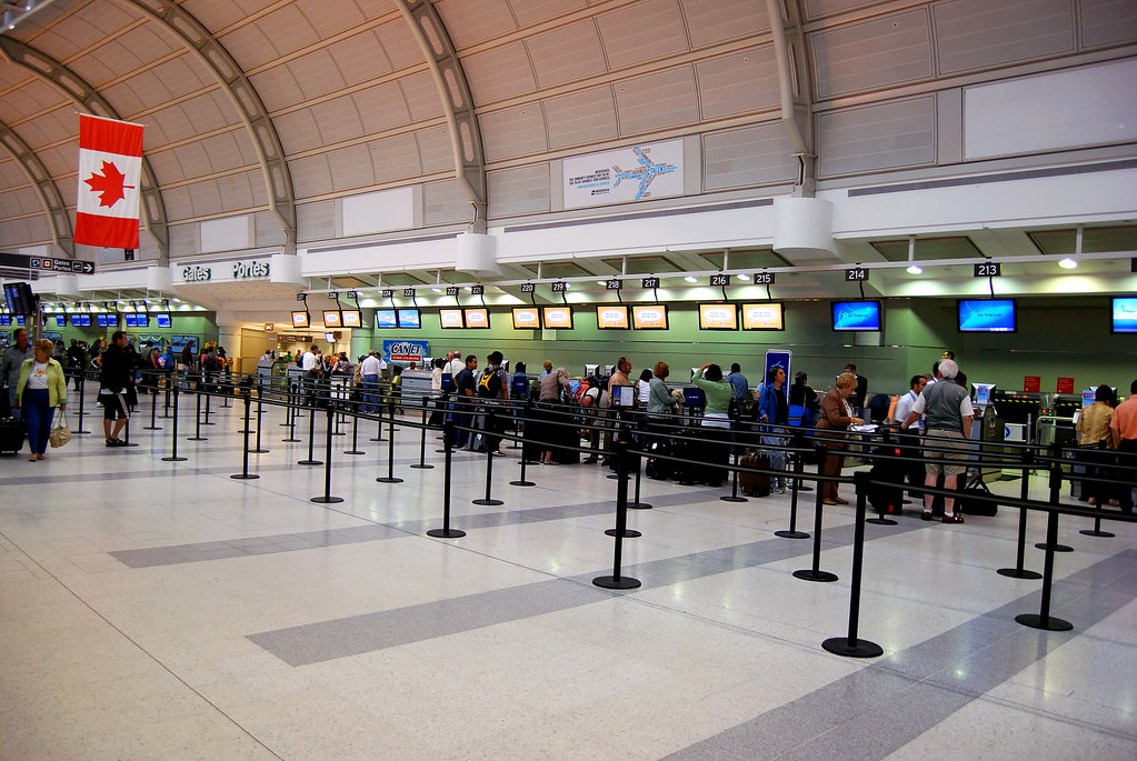People in line at airport terminal - Pearson International Airport Toronto