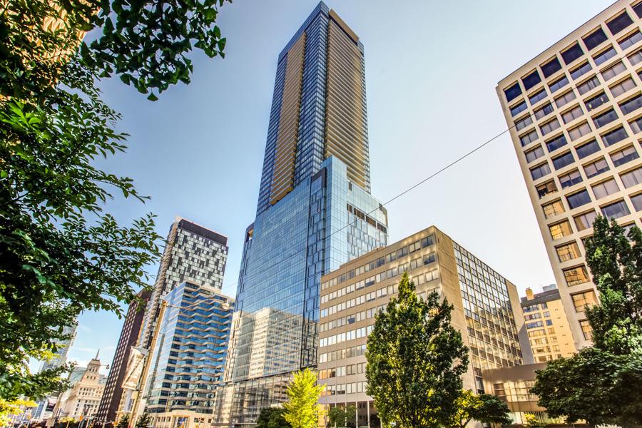Exterior of 488 University Avenue, a 55-storey condo of blue glass.