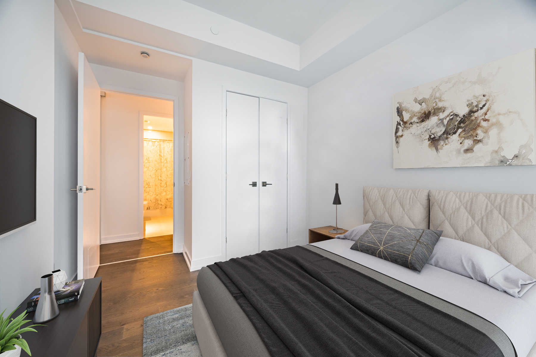 Condo bedroom with hardwood floors, gray walls and large closet.