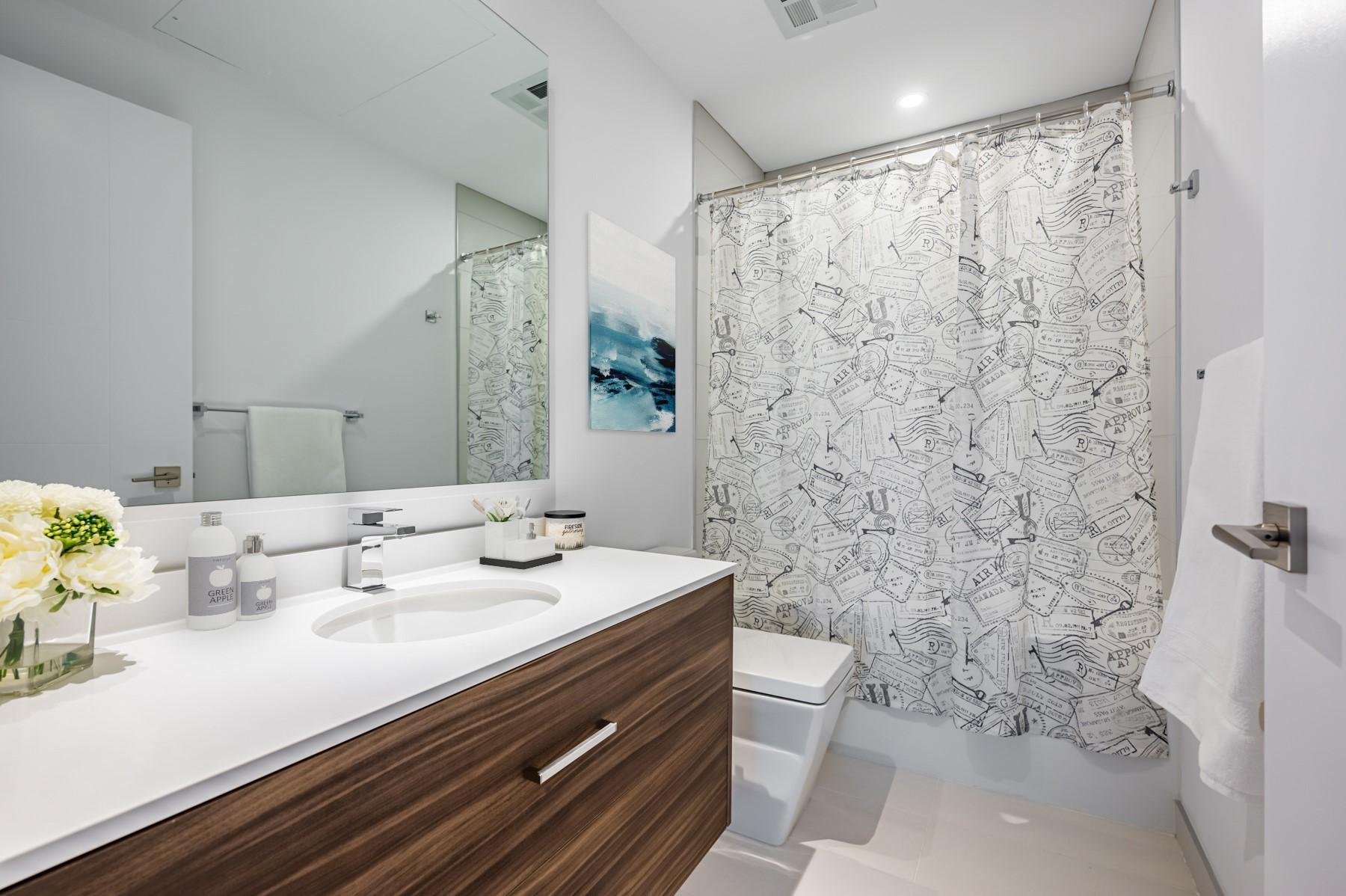 4-piece washroom quartz counter and gray and white colours.
