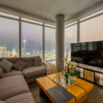 488 University Ave 4610 - living room windows with view of city and CN Tower lights.