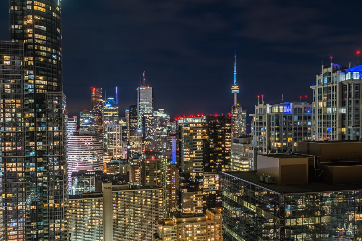 Brightly lit Toronto skyline at night and CN Tower.