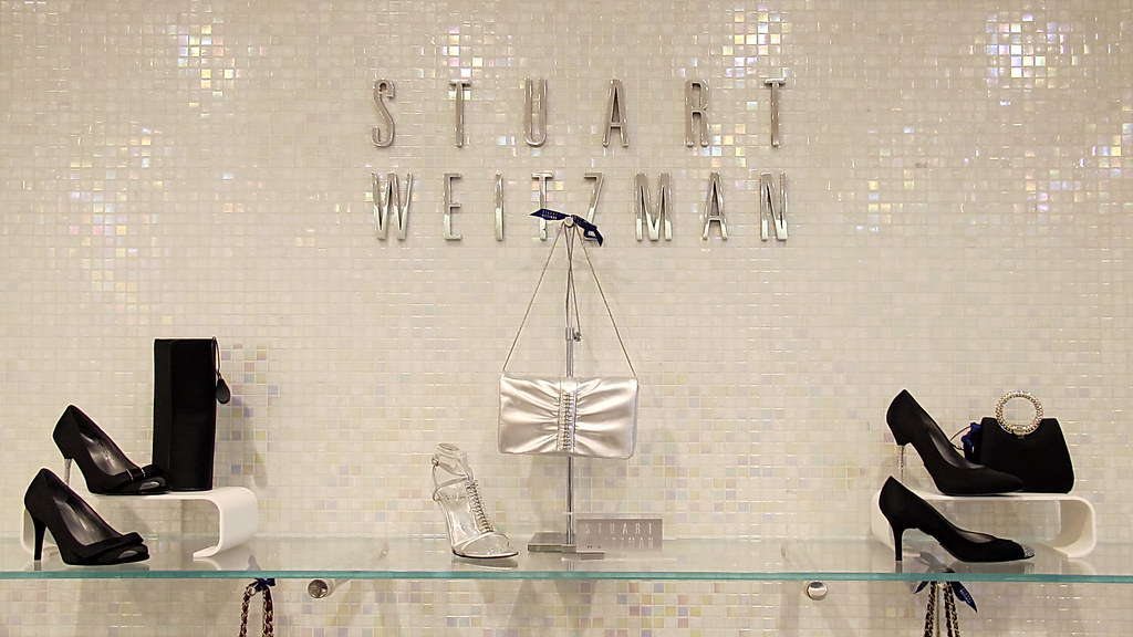 Stuart Weitzman Store display with women's shoes and purses.