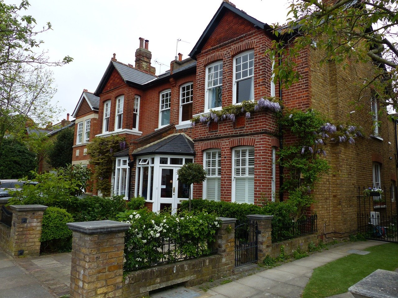 Victorian-era house with red-brick facade.