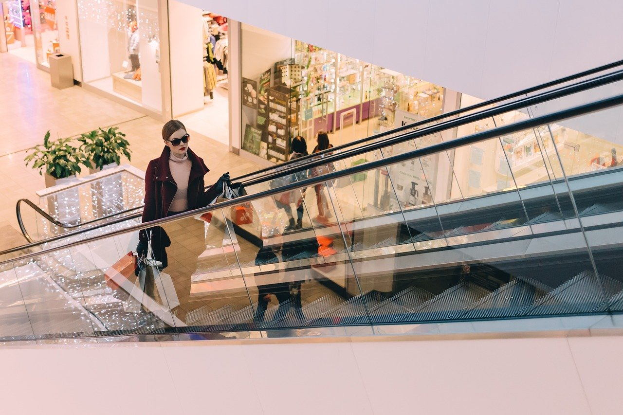 Young woman on mall escalator in Dovercourt Wallace Emerson Junction.