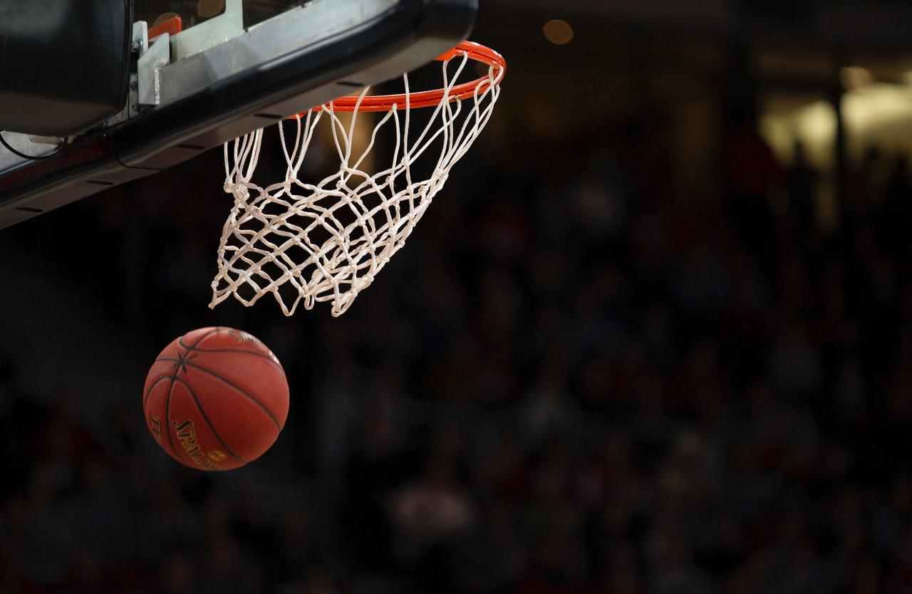 close up basketball going through hoop