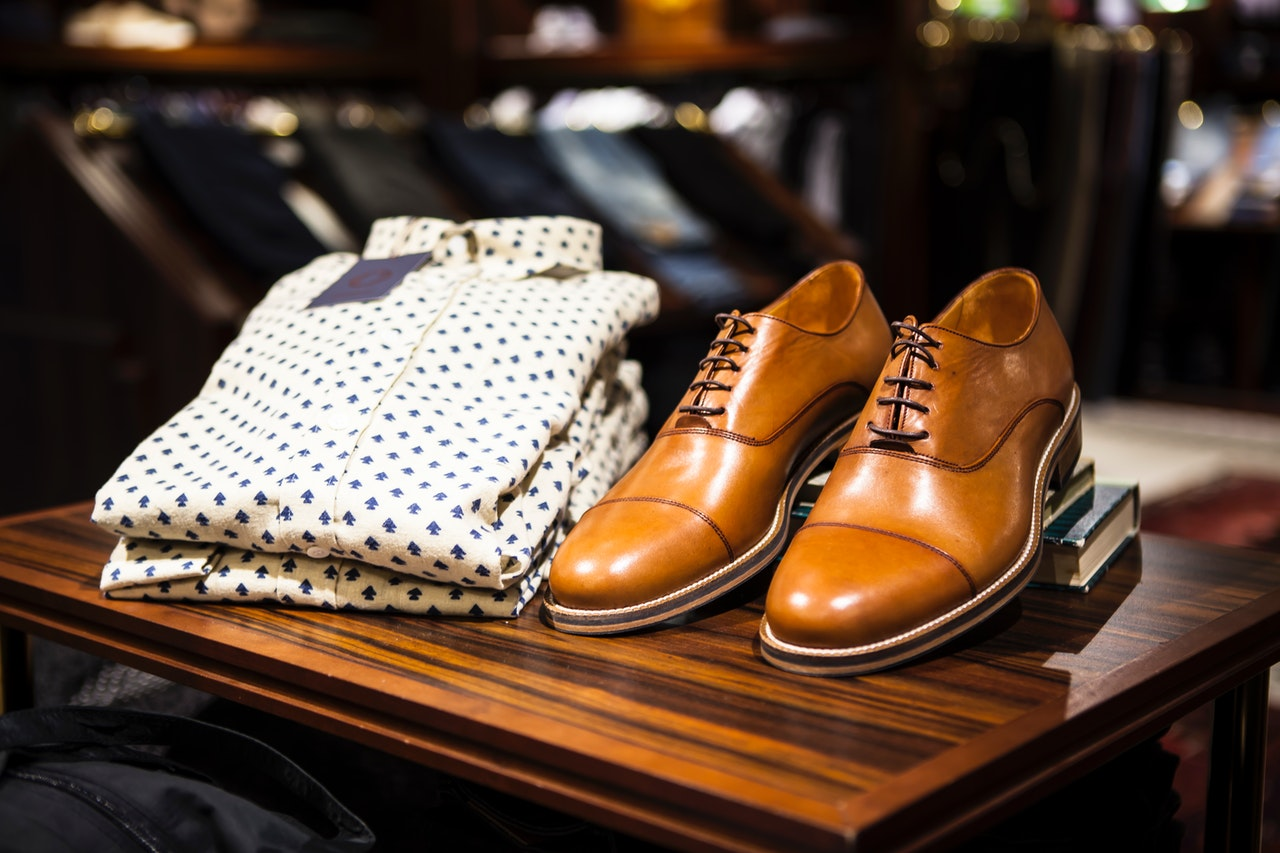 Man's short and brown leather shoes on display at store.