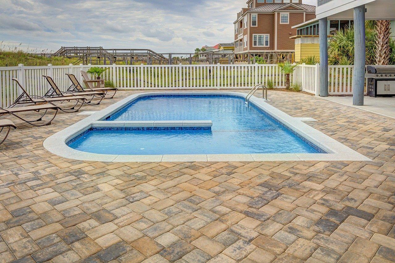 Outdoor swimming pool in backyard.