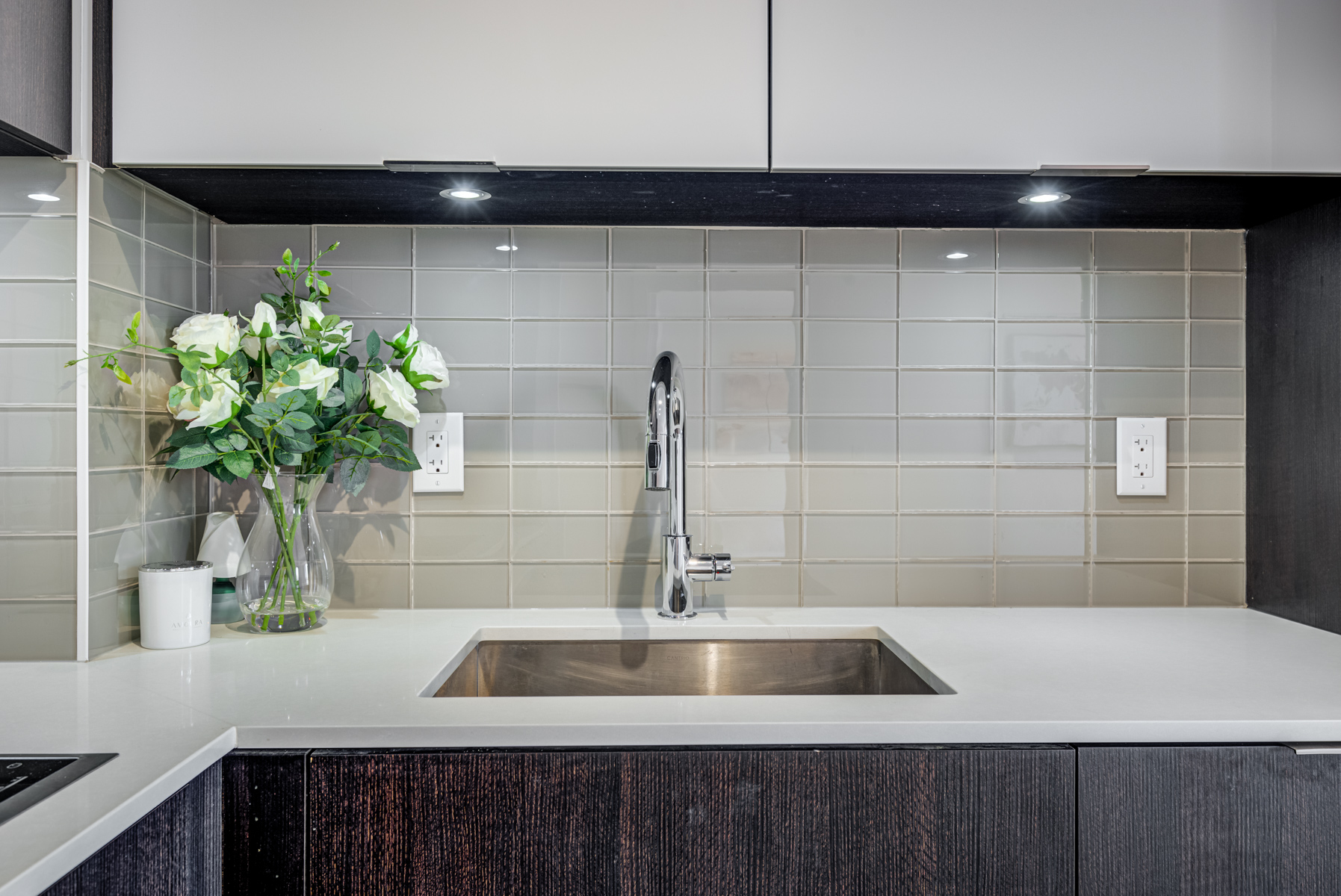 Newly renovated condo kitchen as one way to increase property value.