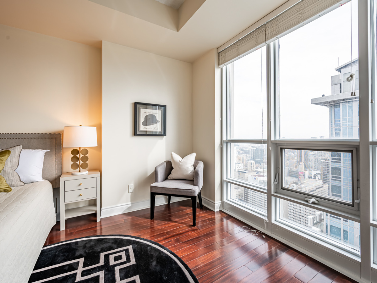 Bright floor-to-ceiling windows with view of downtown Toronto.