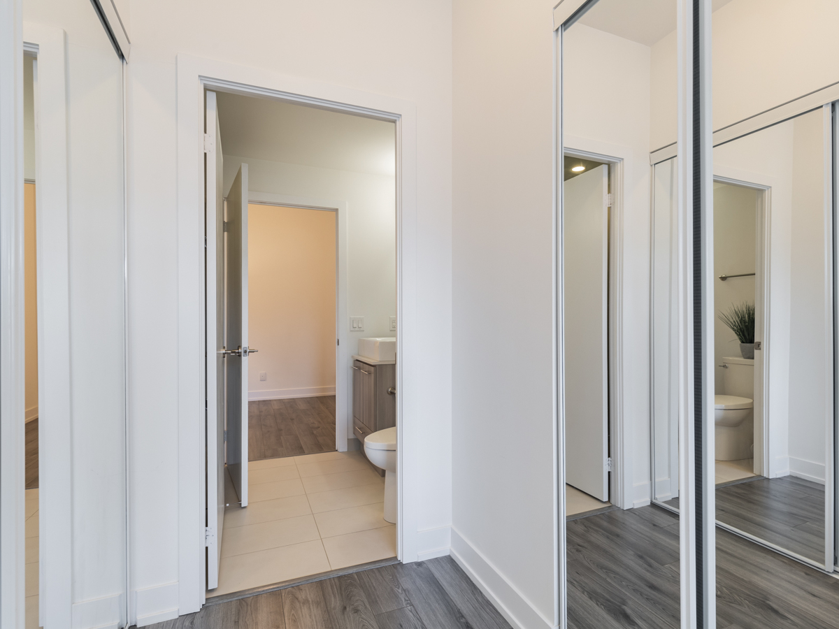 Condo with two mirror-door closets on either side.