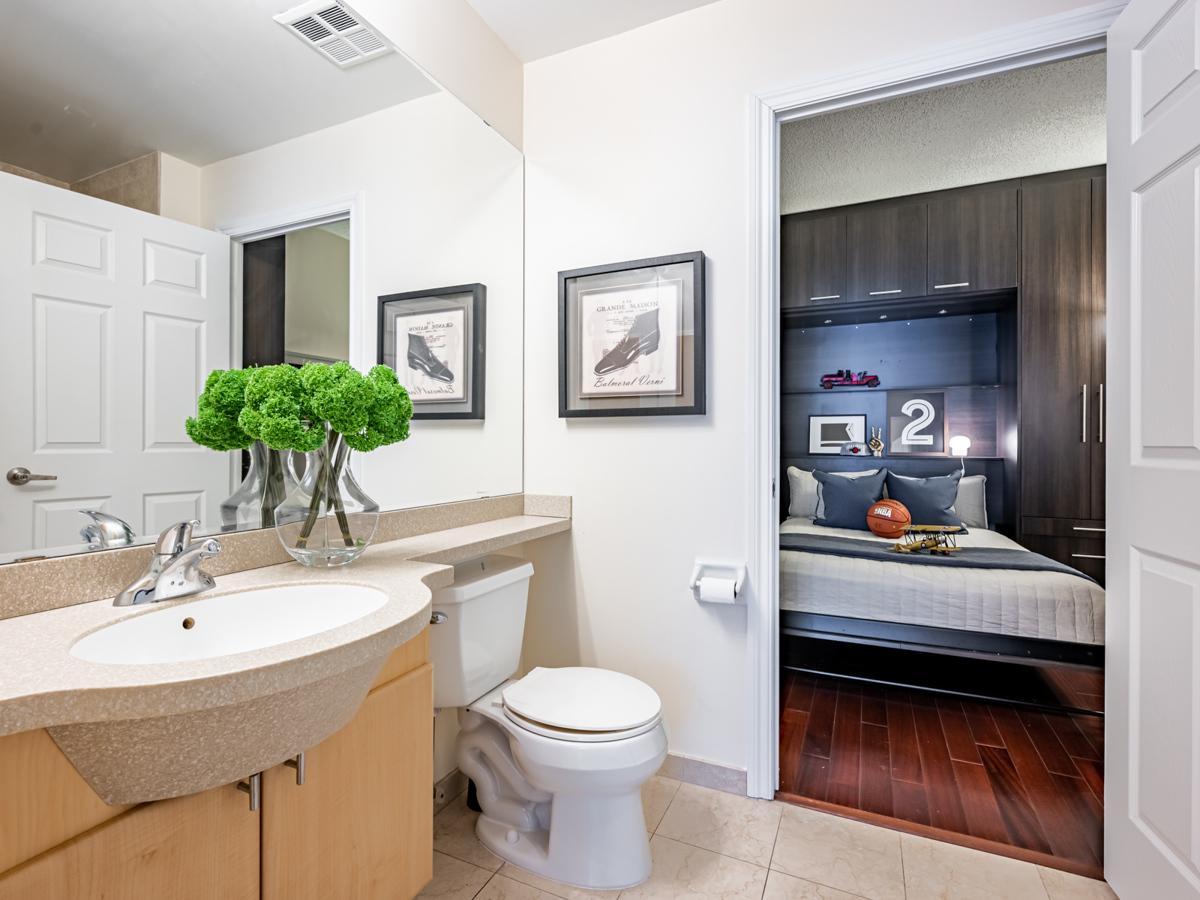 View of condo den through bathroom.