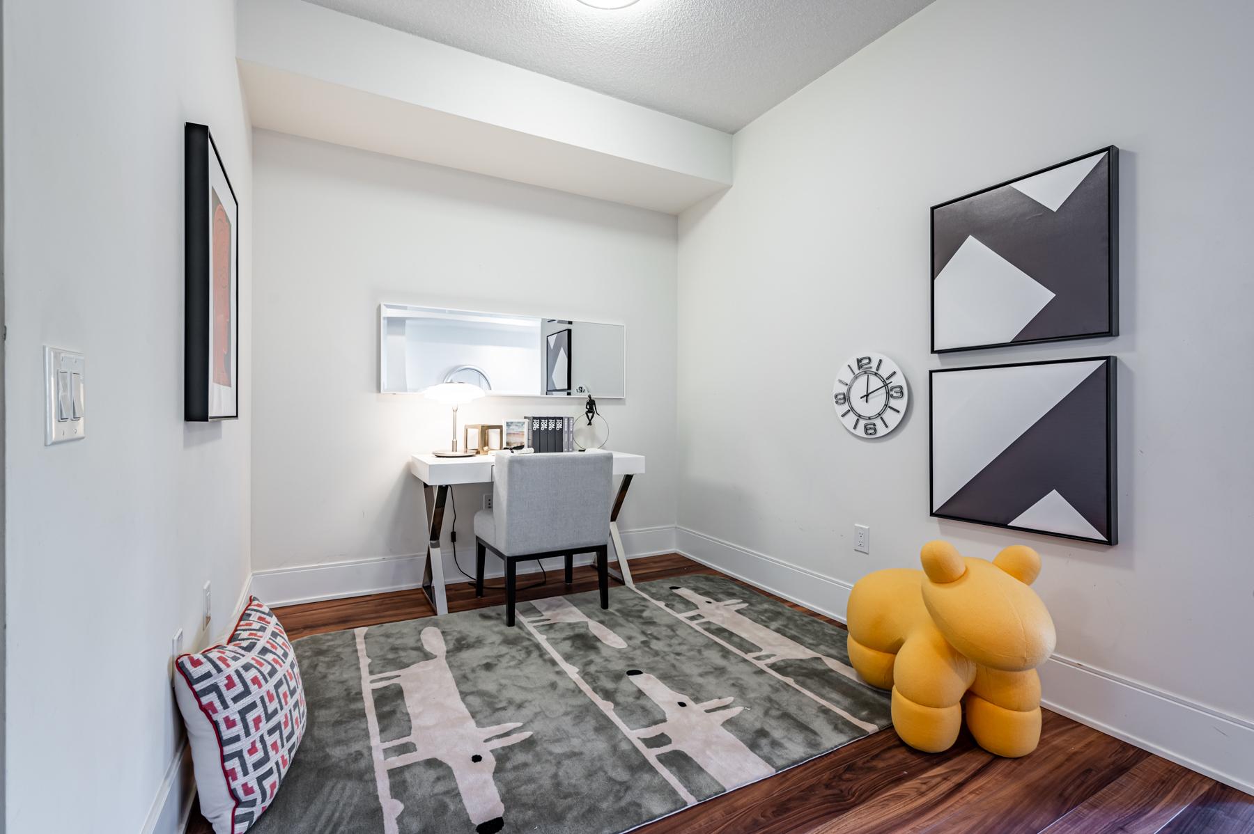 Condo den with home office.