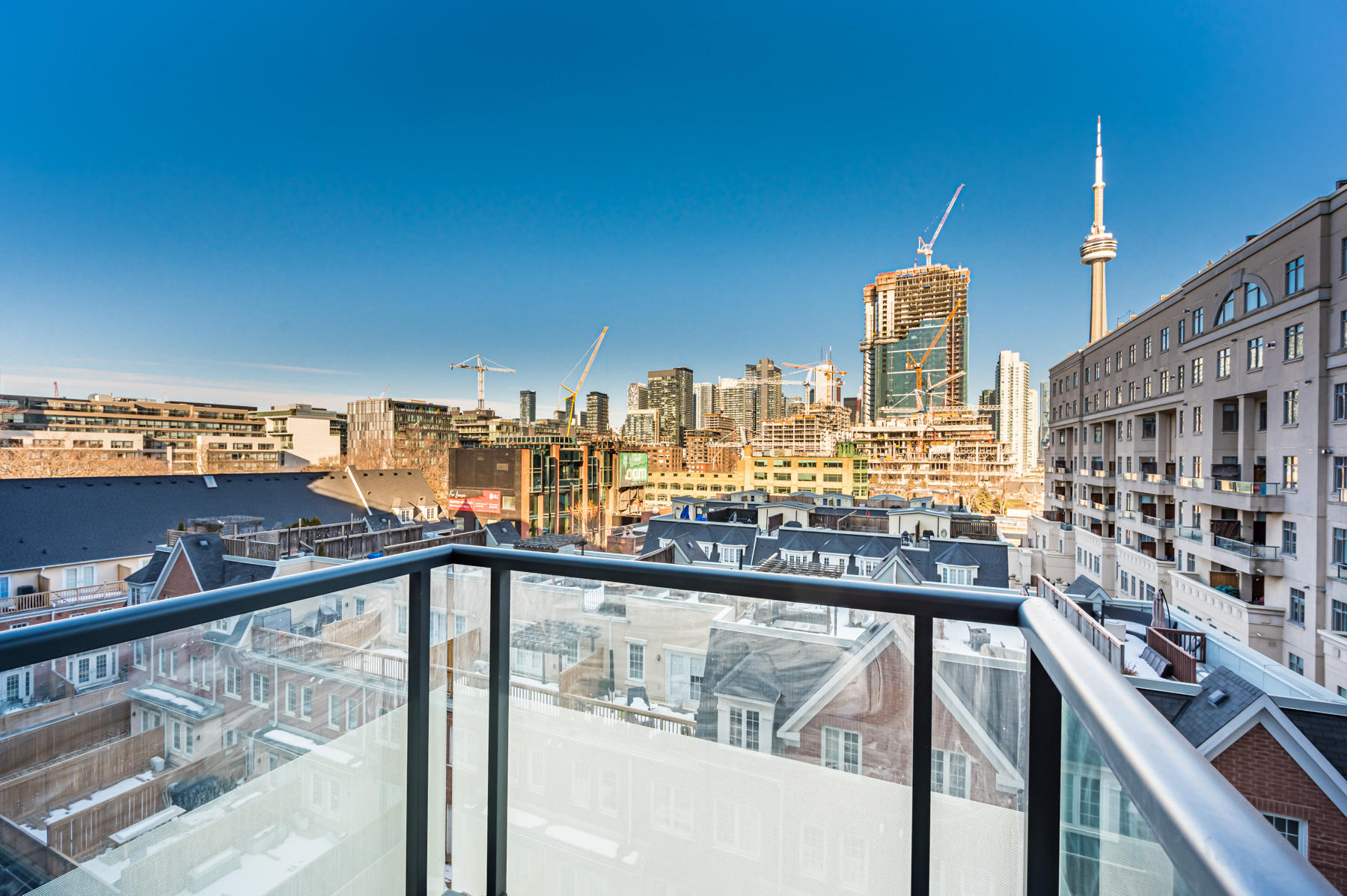 560 Front St W Unit 622 balcony with view of houses, condos and CN Tower in distance.