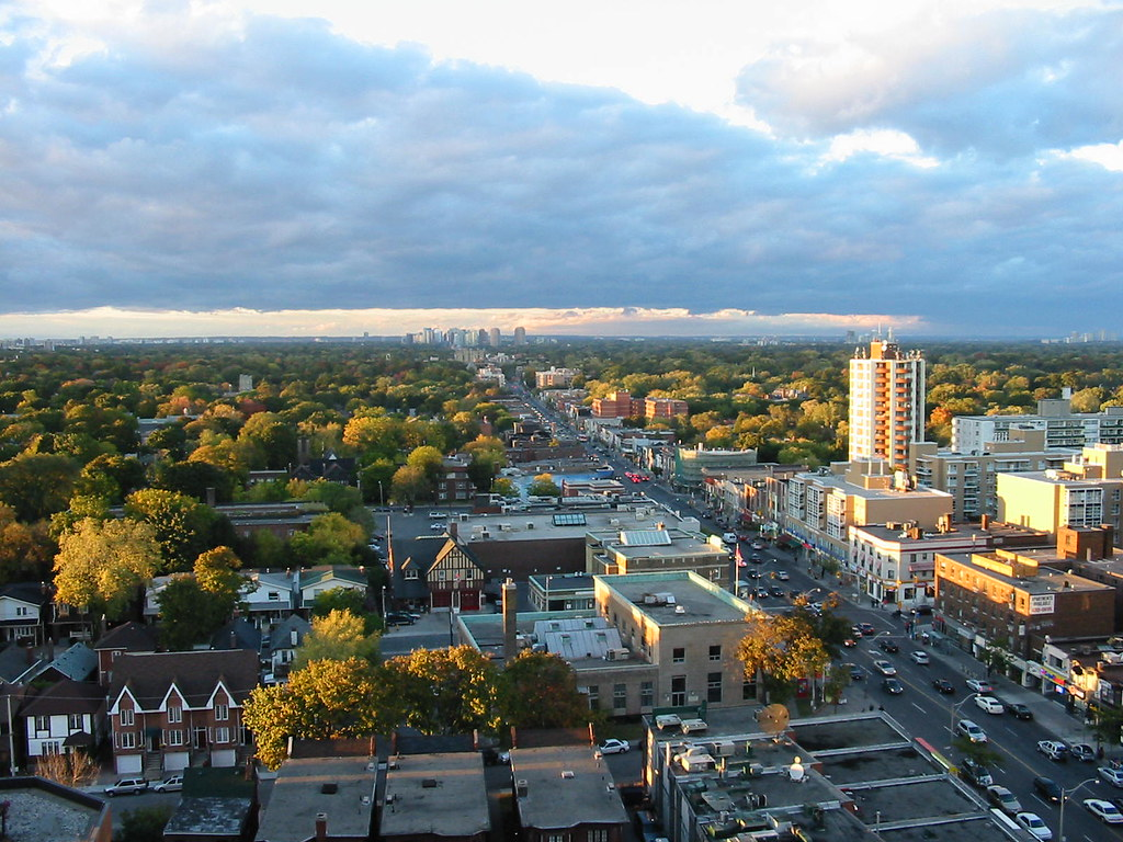 Ariel view of Midtown Toronto showing tree tops, streets and buildings.