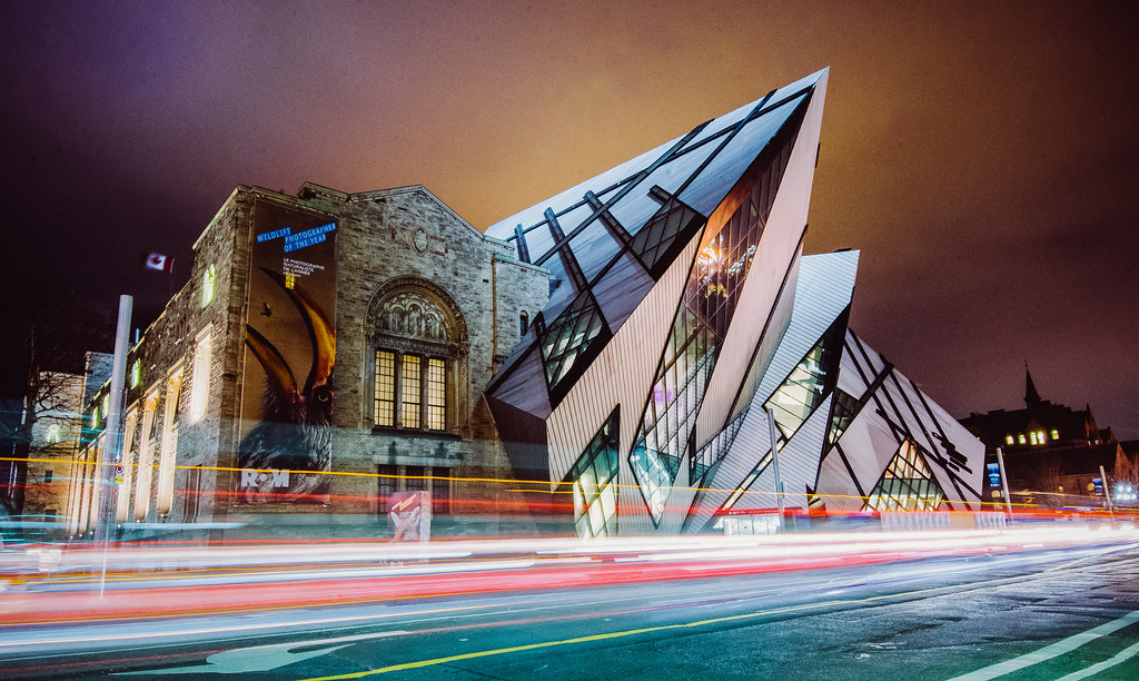 Royal Ontario Museum at night with traffic light trails.