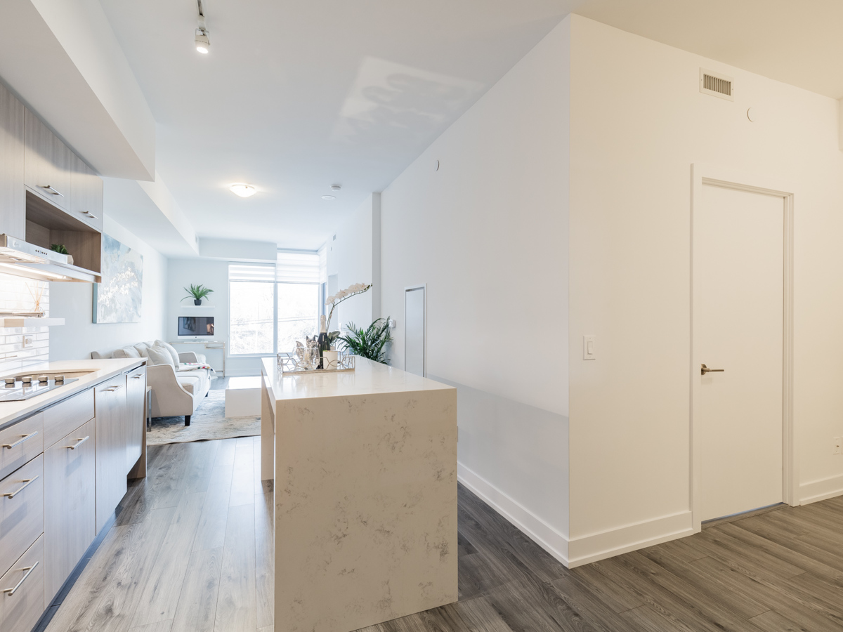 170 Chiltern Hill Rd Unit 410's brightly lit kitchen and living room.