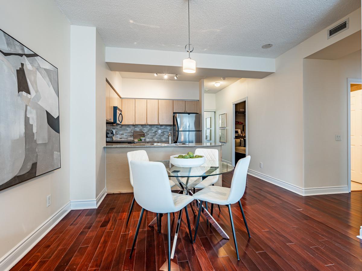 Gray walls and vivid red hardwood floors of 763 Bay St Unit 4705.