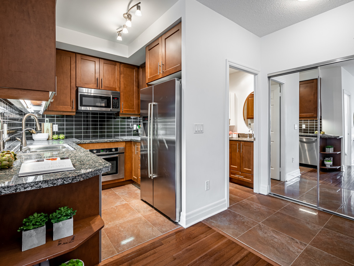 35 Balmuto St Unit 1407 u-shaped kitchen with shelves mounted to counter-tops.