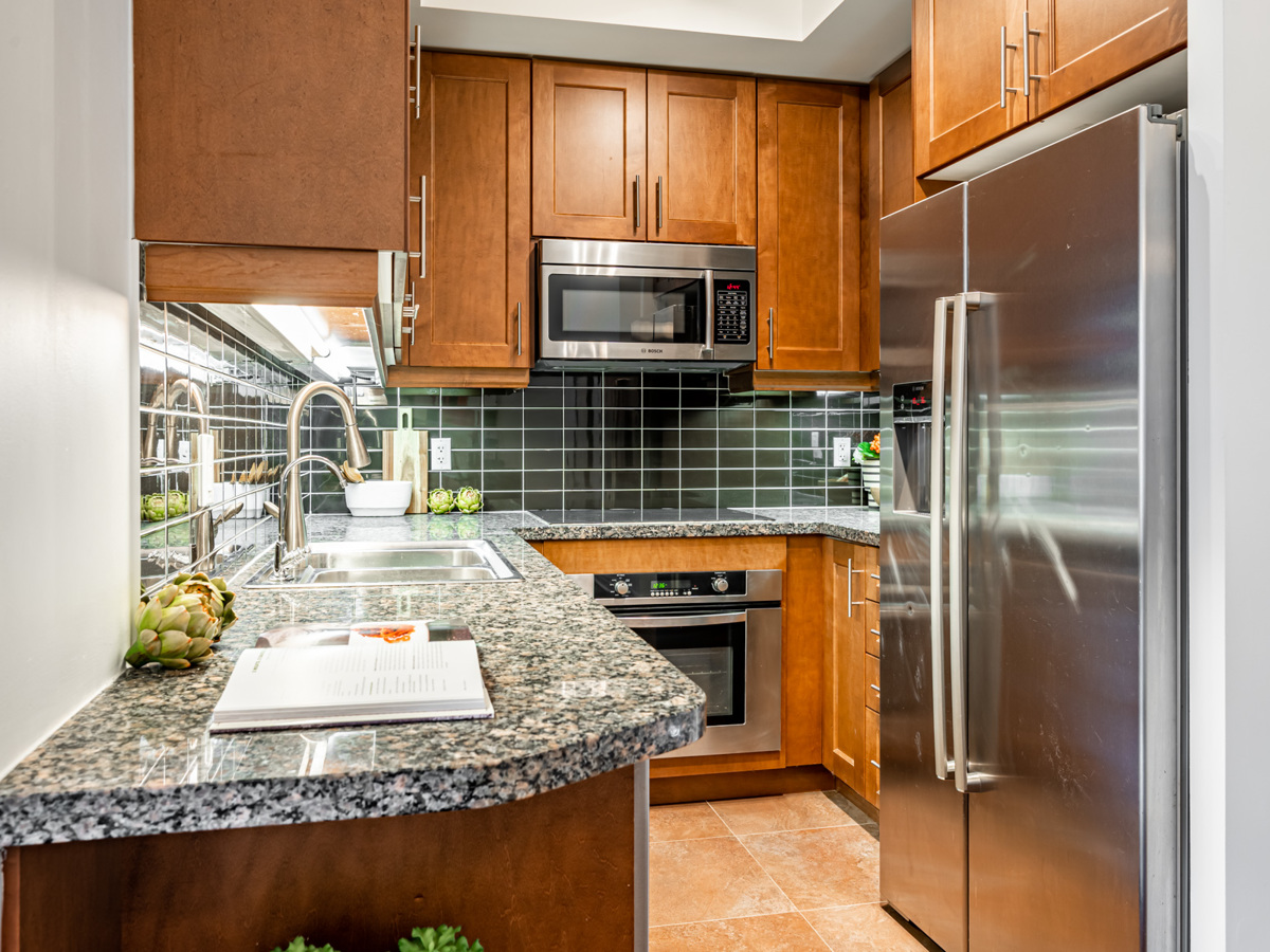 35 Balmuto St # 1407 kitchen with under-cabinet florescent lights and stainless-steel appliances.