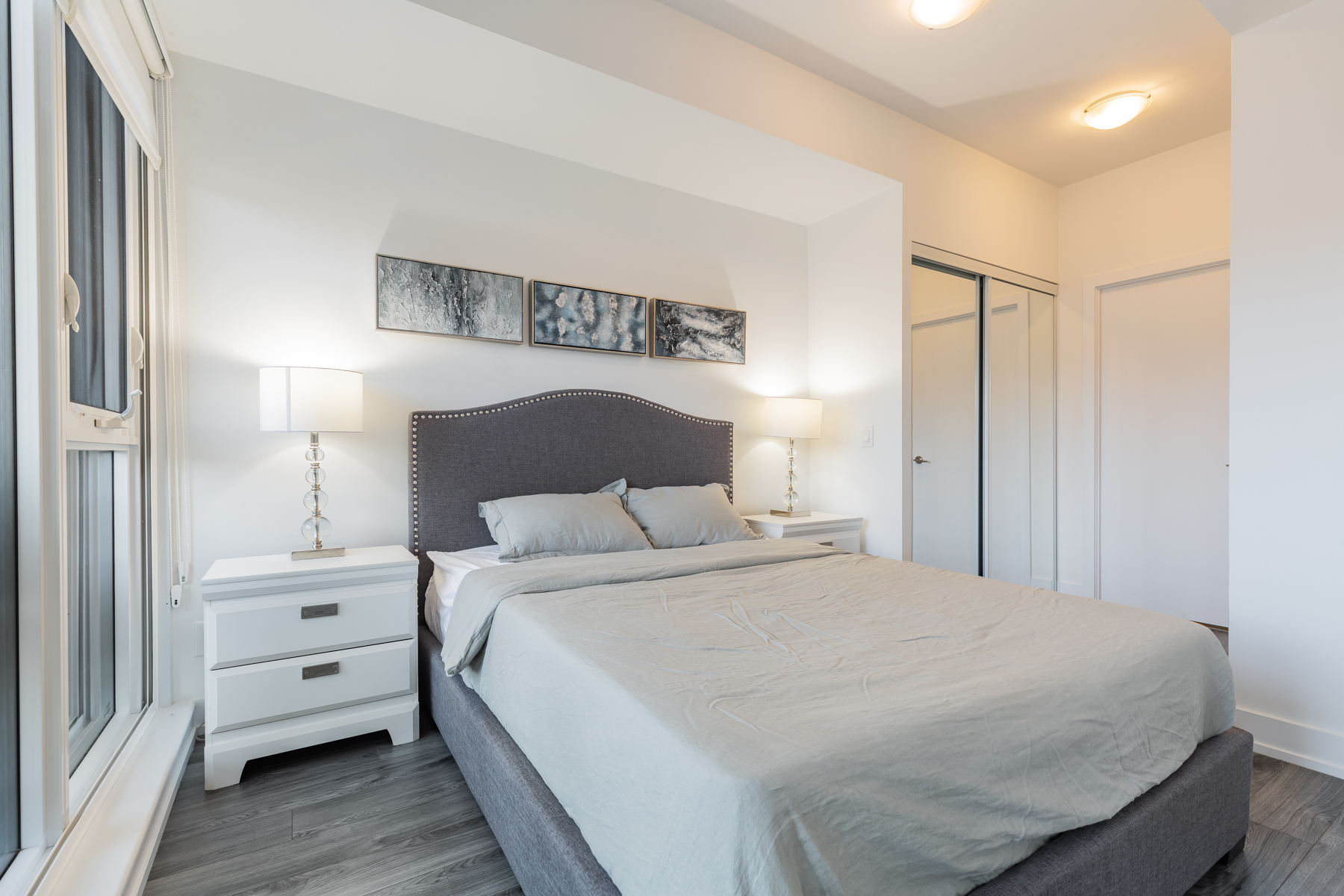 170 Chiltern Hill Unit 410 master bedroom with tall ceilings and huge bed.