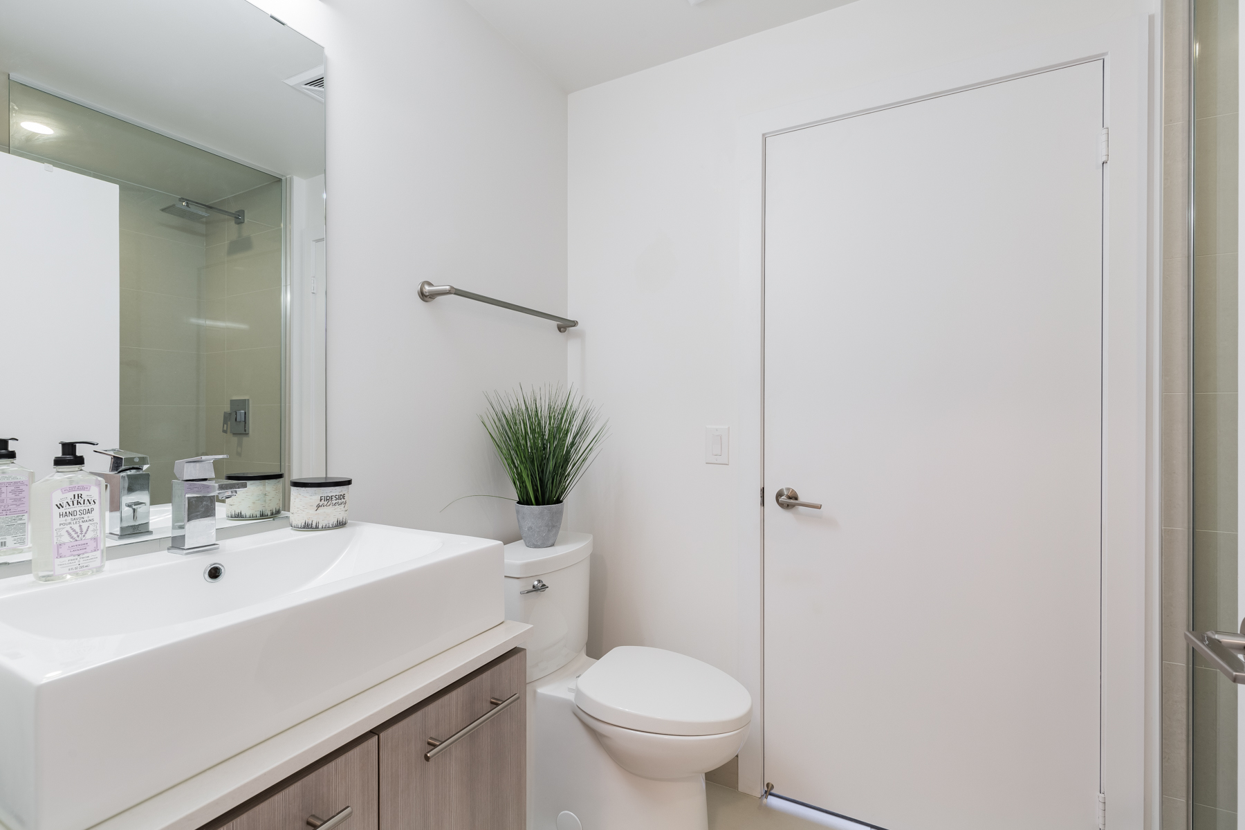 170 Chiltern Hill Rd Unit 410 bathroom with view of sink, toilet and door.